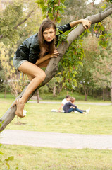 Fashion portrait of young sensual lady on tree