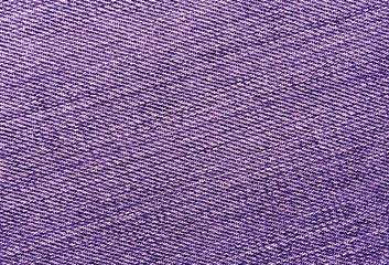 Close-up of purple jeans cloth.