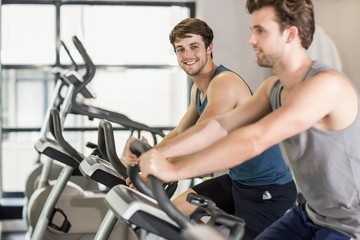 Fit people doing exercise bike