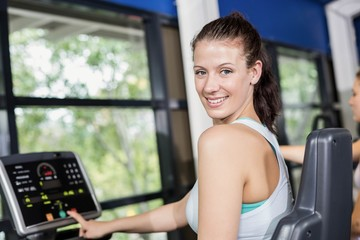 Fit woman doing exercise bike