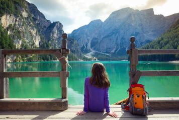 girl backpacker looking at Braies lake