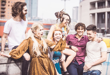 Group of  friends laughing out loud outdoor, sharing good emotions