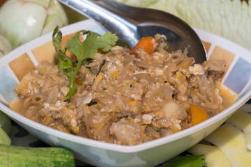 Thai style crab stew in coconut milk with fresh vegetable is one of a delicious Thai food, on wooden background
