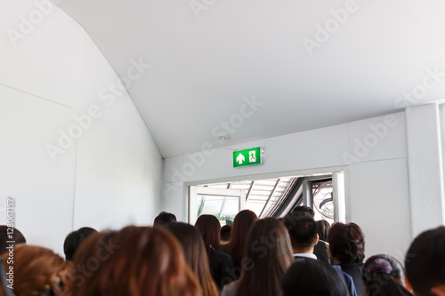 Wall mural People escape to fire exit door