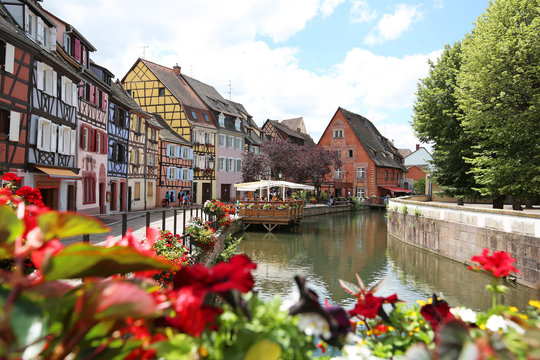 Colorful traditional french houses on the side of river Colmar, France, Alsace