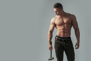 sexy muscular man with hammer Wall mural