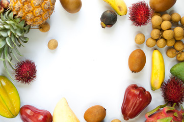 A frame of tropical fruits on white background isolated