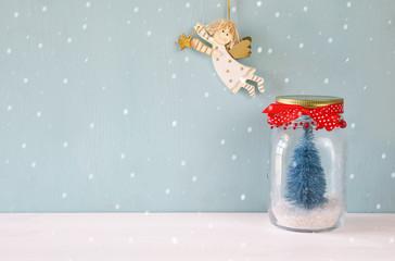 mason jar with christmas tree and flying angel