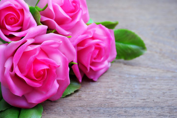 Pink roses on wooden background, valentines concept.