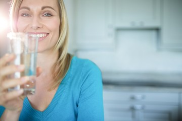Pretty blonde woman drinking a glass of water