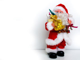 New year, Christmas toy Santa Claus with gifts bag on white background