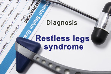 Diagnosis of Restless legs syndrome. Two neurological hammer, result of mental status exam and name of neurologic psychiatric diagnosis Restless legs syndrome on a white background or on doctor table