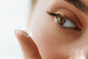 Vision Contact Lenses. Closeup With Beautiful Woman Face