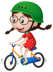 Little girl riding bike with helmet on