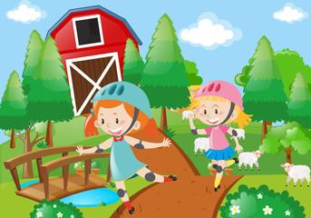 Two girl rollerskate in the farmyard