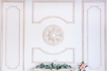 antique stucco molding on a wall. Classical elements in an interior. Light room