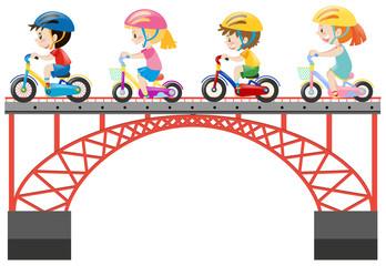 Children riding bike on the bridge