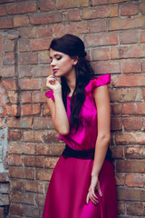 beautiful girl in purple evening dress