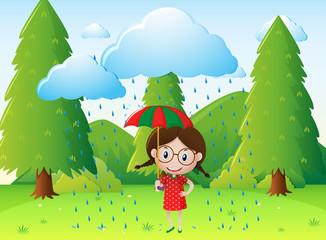 Park scene with girl in the rain