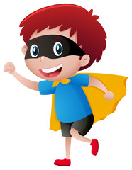 Little boy wearing mask and cape