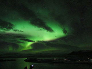 Admiring the awesome northern lights dancing over Jokulsarlon Glacier Lagoon, the southern part of Iceland