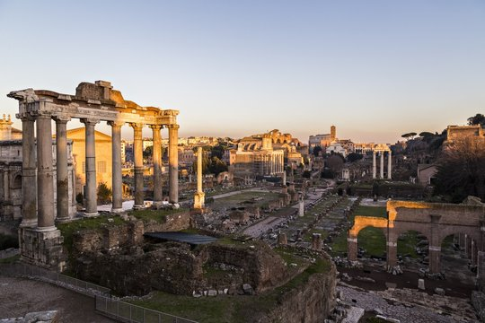 Sunset light on the Roman Forum, the Colosseum in the background, Rome, Italy