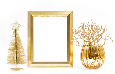 Golden picture frame and shiny christmas ornaments