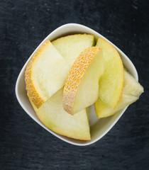 Rustic slate slab with Honeydew Melon (selective focus)