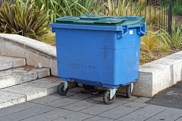 Blue trash container