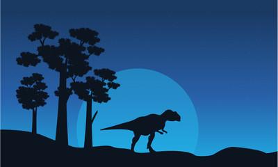 Silhouette of mapusaurus on blue sky landscape