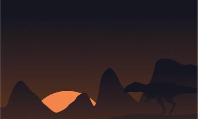 Silhouette of mapusaurus on brown sky landscape