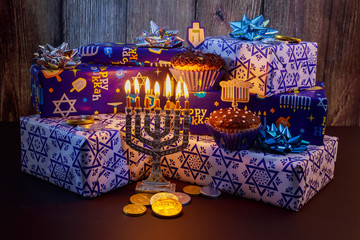 Jewish holiday HanukkahBeautiful Chanukah decorations in blue and silver with gifts