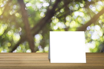 Wooden desk or wooden floor on green bokeh background.use for present or mock up your product