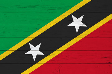 Flag of Saint Kitts and Nevis on wooden background