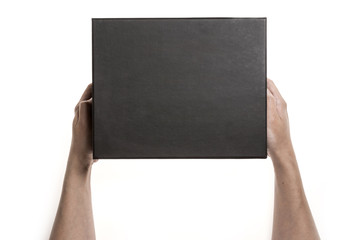 Two hands hold a empty(blank) black gift box isolated white