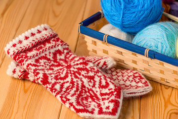 warm mittens knitted with a pattern of skillfully a professional