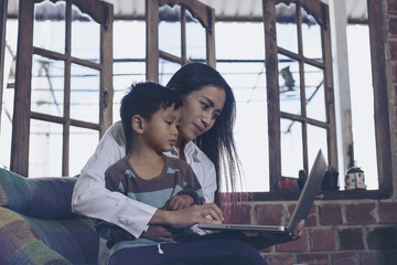 Little boy and his mother living notebook happily. Holiday their