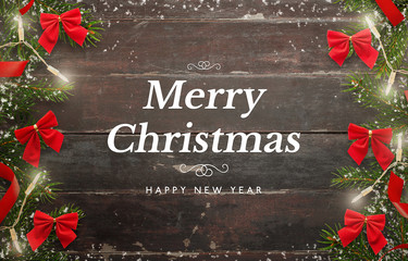 Merry Christmas and Happy New Year card. Wooden table with Christmas tree and decorations.