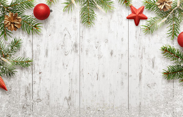White Christmas background with tree and decorations. Lights, ball, pine cone beside. Top view with free space for greeting card text.