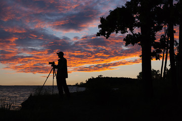Silhouette of the photographer on the background of a beautiful