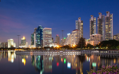 Light in the city, beautiful view, flowers foreground and reflection, Bangkok, Thailand