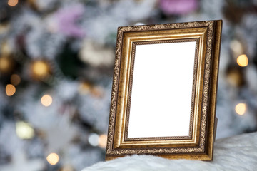 Empty blank photo frame in christmas decorated defocused background with toys lights