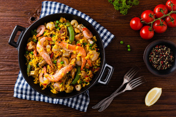 Traditional Spanish paella with seafood and chicken.