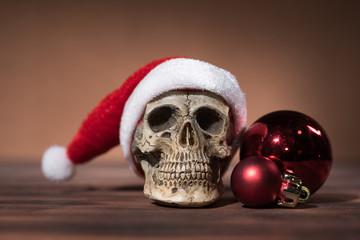 Still life with santa claus skull and red christmas balls