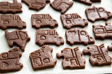 cutting cookies dough cars shape. homemade bakery