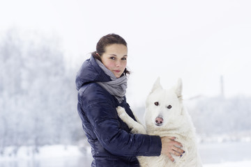 Girl and dog on a winter walk