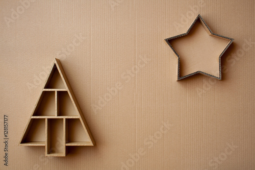 Christmas Tree And Star Shaped Gift Boxes On Cardboard Background