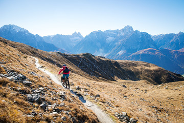Woman mountain biking in Dolomites, South Tyrol, Italy