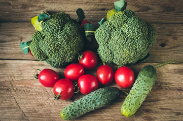 Fresh Raw Broccoli, Cheery tomatoes and cucumbers.Vegetables