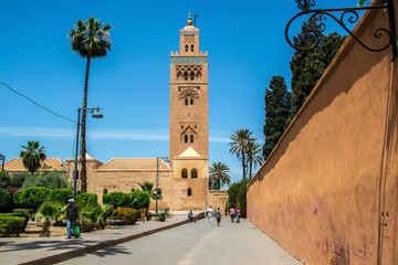 The Koutoubia Mosque or Kutubiyya Mosque at night, it is the lar